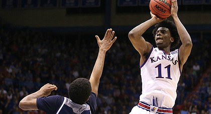 Kansas guard Josh Jackson (11) pulls up for a shot over Washburn guard Cameron Wiggins (11) during the second half, Tuesday, Nov. 1, 2016 at Allen Fieldhouse.
