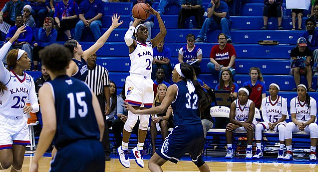 Kansas sophomore McKenzie Calvert pulls up for a jumper during the team's exhibition game against Washburn University on Sunday, Nov. 6, 2016.