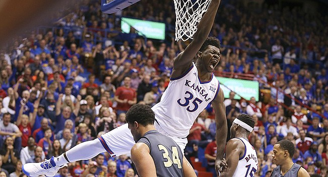 Kansas center Udoka Azubuike (35) roars after finishing a dunk off of a lob against Emporia State during the first half, Sunday, Nov. 6, 2016 at Allen Fieldhouse.