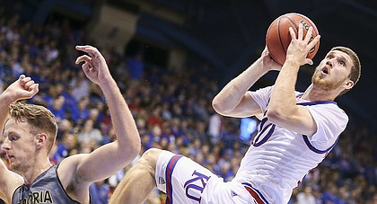 Kansas guard Sviatoslav Mykhailiuk (10) puts up an off-balance shot after being fouled by Emporia State center Bradley Fisher (41) during the second half, Sunday, Nov. 6, 2016 at Allen Fieldhouse.