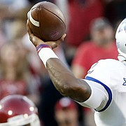 Kansas quarterback Montell Cozart (2) passes against Oklahoma during the first half of an NCAA college football game in Norman, Okla., Saturday, Oct.29, 2016.
