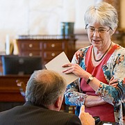 In this file photo from June 2015, Sen. Marci Francisco, D-Lawrence, right, discusses tax issues on the floor of the Kansas Senate.