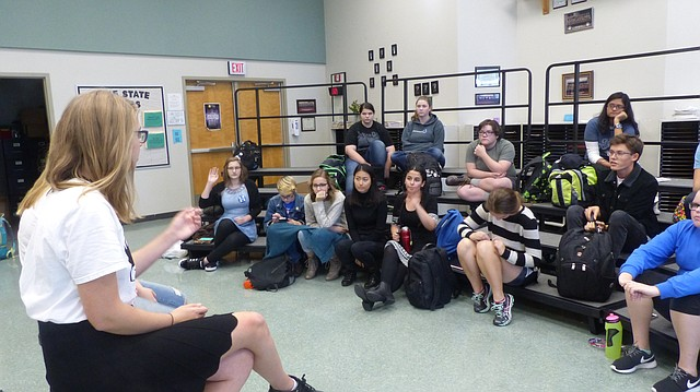 Free State High School Young Feminists Club co-president Meredith Shaheed, left, addresses members of her club during a meeting Wednesday afternoon at the high school, 4700 Overland Drive. Club members spent the meeting reflecting on the results of the 2016 presidential election.
