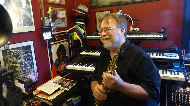 Local musician Gary Frager, pictured here in his Lawrence home on Nov. 10, will be inducted into the Kansas Music Hall of Fame next spring with his band, Caribe. The band, which was active on and off throughout the 1980s and 90s, was known for its reggae-Latin sound.
