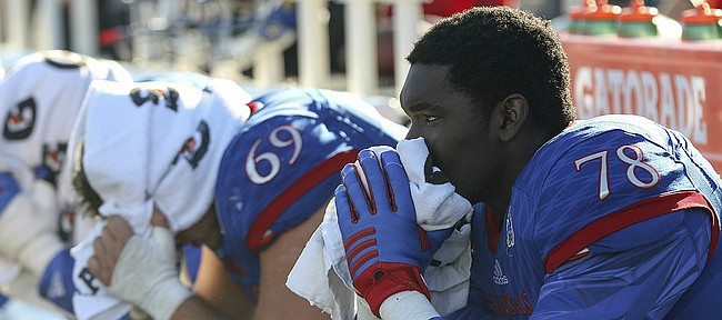 Kansas offensive lineman Mesa Rigordy (69) and Hakeem Adeiji (78) watch the closing seconds of the Jayhawks 31-24 loss to Iowa State, Saturday, Nov. 12 at Memorial Stadium.