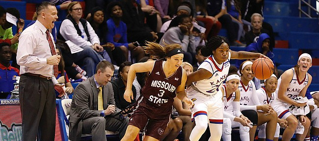 Kansas guard Jayde Christopher (20) steals the ball from Missouri State player Lexi Hughes in front of the KU bench during the Jayhawks game against the Missouri State Lady Bears Sunday, Nov. 13, 2016 at Allen Field House.