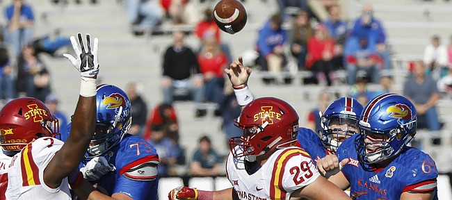 Kansas quarterback Carter Stanley (9) tosses from behind his offensive line in the first half of KU's 31-24 loss to Iowa State, Saturday, Nov. 12 at Memorial Stadium.