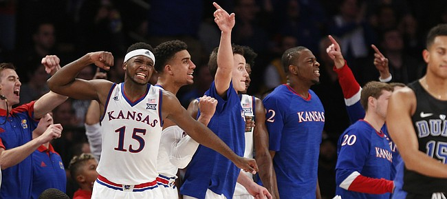 The Kansas bench erupts after a foul called against Duke during the Champions Classic on Tuesday, Nov. 15, 2016 at Madison Square Garden in New York.