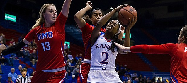 Kansas sophomore guard McKenzie Calvert tries to fight through SMU center Klara Bradshaw (13) during Wednesday's game at Allen Fieldhouse.