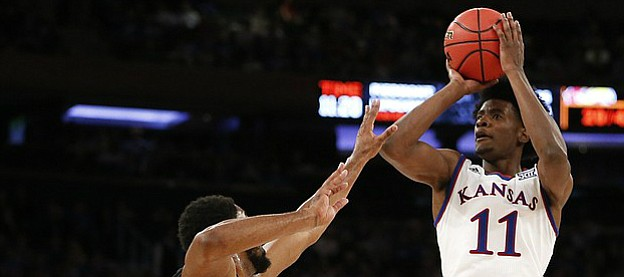 Kansas guard Josh Jackson (11) pulls up for a jumper over Duke guard Matt Jones (13) during the second half of the Champions Classic on Tuesday, Nov. 15, 2016 at Madison Square Garden in New York.