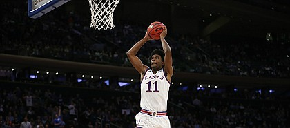 Kansas guard Josh Jackson (11) soars in to the bucket for a jam during the second half of the Champions Classic on Tuesday, Nov. 15, 2016 at Madison Square Garden in New York.
