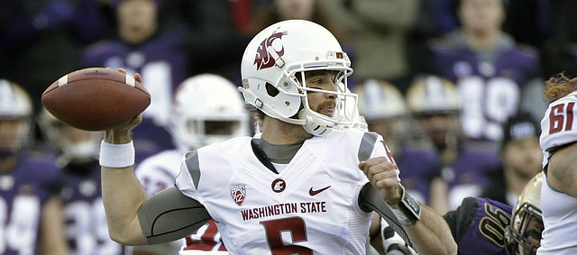Washington State quarterback Peyton Bender (6) drops back to pass against Washington in the first half of an NCAA college football game Friday, Nov. 27, 2015, in Seattle. (AP Photo/Elaine Thompson)