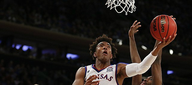 Kansas guard Devonte' Graham (4) gets under the bucket for a shot before Duke forward Amile Jefferson (21) during the first half of the Champions Classic on Tuesday, Nov. 15, 2016 at Madison Square Garden in New York.