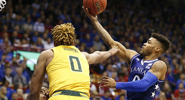 Kansas guard Frank Mason III (0) floats in to the bucket past Siena forward Javion Ogunyemi (0) during the first half, Friday, Nov. 18, 2016 at Allen Fieldhouse.