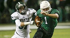 Free State junior linebacker David Johnson chases after Derby running back Brody Kooser (1) during the Class 6A state semifinals on Friday at Panther Stadium.