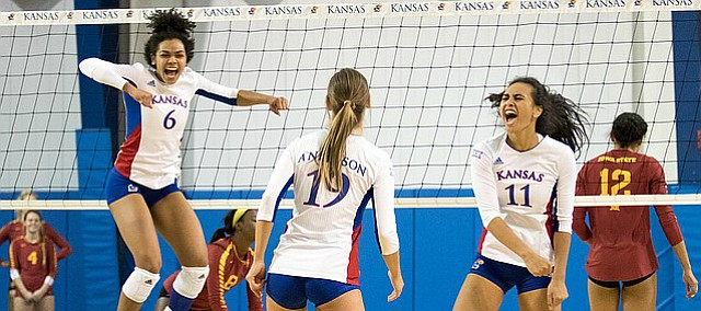 Kansas freshman Zoe Hill (6), left, senior Maggie Anderson and junior setter Ainise Havili celebrate a point against Iowa State on Saturday, Nov. 19, 2016 at Horejsi.