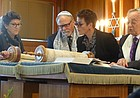 Herb Friedson, right, recites passages from the Torah for his bar mitzvah on Saturday, Nov. 19, 2016 at the Lawrence Jewish Community Center. Friedson decided to do the ritual 70 years after his first bar mitzvah, for his 83rd birthday, as a way to give thanks for his good health. Following along with him during the service, from left, are Cheryl Lester, Steve Hurst and Melanie Cohavi.