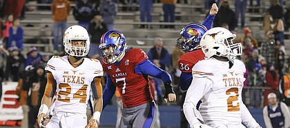 Kansas place kicker Matthew Wyman (7) and holder Cole Moos (36) go wild after Wyman's game-winning field goal in overtime against Texas on Saturday, Nov. 19, 2016 at Memorial Stadium.