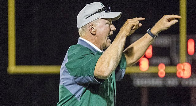 Free State High coach Bob Lisher yells instructions to his defense from the sidelines  during the Firebirds' homecoming game against Olathe South on Friday night at FSHS.