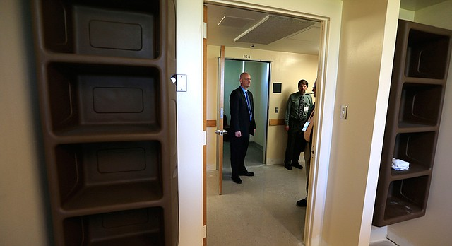 Kansas Department for Aging and Disability Services Interim Secretary Tim Keck, left, takes a tour of Osawatomie State Hospital led by hospital superintendent John Worley, Friday, April 8, 2016 in Osawatomie.