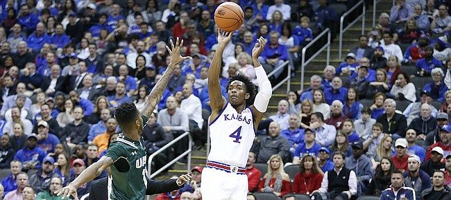Kansas guard Devonte' Graham (4) pulls up for a three o over UAB guard Dirk Williams (11) during the first half of the CBE Classic on Monday, Nov. 21, 2016 at Sprint Center.
