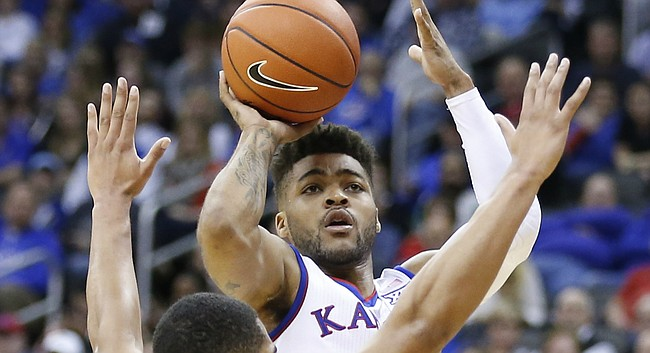 Kansas guard Frank Mason III (0) pulls up for a shot over Georgia guard Juwan Parker (3) during the first half, Tuesday, Nov. 22, 2016 during the championship game of the CBE Classic at Sprint Center.