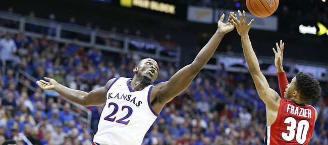Kansas forward Dwight Coleby (22) tips away a possession from Georgia guard J.J. Frazier (30) during the second half, Tuesday, Nov. 22, 2016 during the championship game of the CBE Classic at Sprint Center.