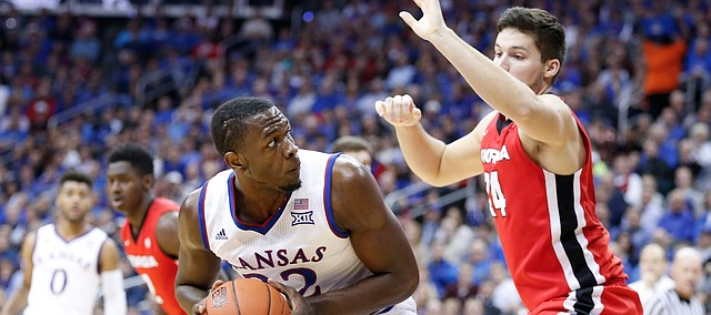 Kansas forward Dwight Coleby (22) looks to take the ball to the bucket against Georgia forward Houston Kessler (24) during the first half, Tuesday, Nov. 22, 2016 during the championship game of the CBE Classic at Sprint Center.