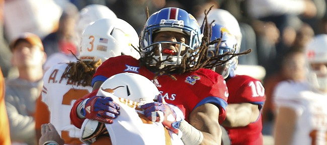 Kansas safety Tevin Shaw (30) stands up Texas quarterback Shane Buechele (7) for a stop during the second quarter on Saturday, Nov. 19, 2016 at Memorial Stadium.