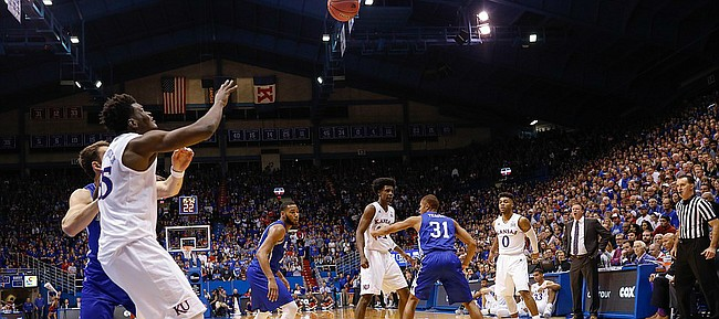 Kansas center Udoka Azubuike (35) left, readies for a pass from Kansas guard Frank Mason III (0), right, in the Jayhawks 95-57 win against UNC Asheville Friday night, Nov. 25, in Allen Fieldhouse.