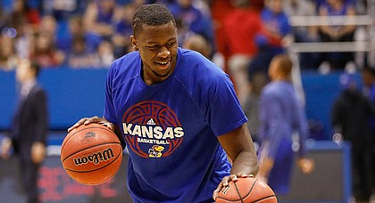 Kansas forward Dwight Coleby warms up before the Jayhawks game against UNC Asheville Friday night, Nov. 25, in Allen Fieldhouse