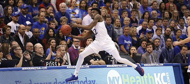 Kansas guard Lagerald Vick (2) runs out of bounds to save the ball in the Jayhawks 95-57 win against UNC Asheville Friday night, Nov. 25, in Allen Fieldhouse.