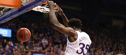 Kansas freshman Udoka Azubuike finishes a dunk during the first half against UNC Asheville on Friday, Nov. 25, at Allen Fieldhouse.