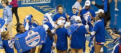 Kansas volleyball players try on their Big 12 Champions hats and shirts after a five-set victory against Iowa State on Saturday, Nov. 19, 2016 at Horejsi Center. The Jayhawks won in five sets, clinching a Big 12 title.