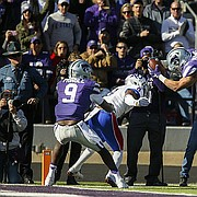 Kansas State running back Alex Barnes (34) gets airborne as he dives over Kansas cornerback Brandon Stewart (8) for a touchdown during the second quarter, Saturday, Nov. 26, 2016 at Bill Snyder Family Stadium.