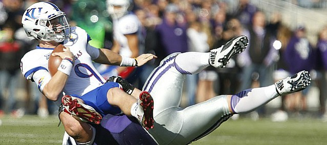 Kansas quarterback Carter Stanley (9) is thrown to the ground by Kansas State defensive tackle Will Geary (60) during the second quarter, Saturday, Nov. 26, 2016 at Bill Snyder Family Stadium.