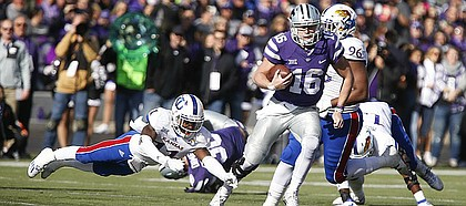 Kansas State quarterback Jesse Ertz (16) avoided a tackle from Kansas linebacker Mike Lee (11) during the second quarter, Saturday, Nov. 26, 2016 at Bill Snyder Family Stadium.