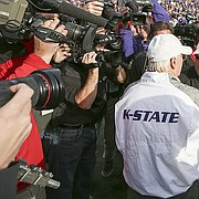 Kansas head coach David Beaty congratulates Kansas State head coach Bill Snyder on his 200th coach win following the Wildcats' 34-19 win over the Jayhawks on Saturday, Nov. 26, 2016 at Bill Snyder Family Stadium.
