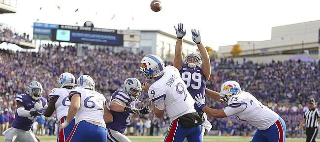Kansas quarterback Carter Stanley (9) heaves a long pass from the Jayhawks' own end zone during the fourth quarter, Saturday, Nov. 26, 2016 at Bill Snyder Family Stadium.