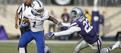Kansas wide receiver LaQuvionte Gonzalez (1) tries to shake Kansas State defensive back Dante Barnett (22) during the fourth quarter, Saturday, Nov. 26, 2016 at Bill Snyder Family Stadium.