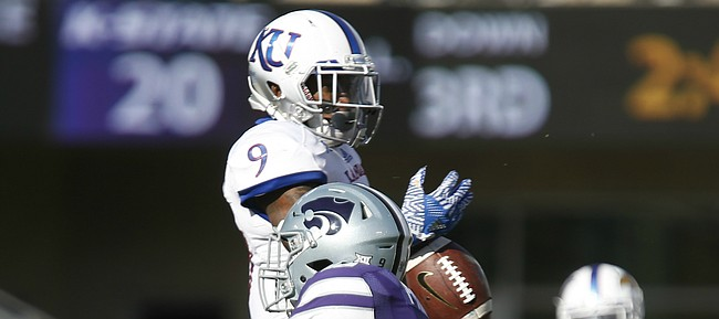 Kansas safety Fish Smithson (9) breaks up a pass to Kansas State wide receiver Byron Pringle (9) during the quarter, Saturday, Nov. 26, 2016 at Bill Snyder Family Stadium.