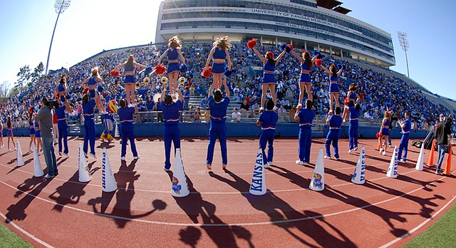 Kansas cheerleaders are hoisted into the air during the spring scrimmage on Sunday, April 15, 2007, at Memorial Stadium.