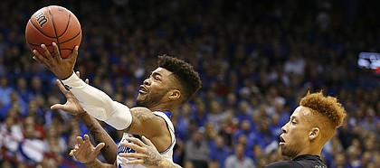 Kansas guard Frank Mason III (0) gets in for a bucket past Long Beach State guard Noah Blackwell (3) during the first half, Tuesday, Nov. 29, 2016 at Allen Fieldhouse.