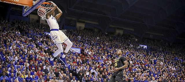 Kansas guard Lagerald Vick (2) gets up for a reverse jam before Long Beach State forward Javonntie Jackson (35) during the first half, Tuesday, Nov. 29, 2016 at Allen Fieldhouse.