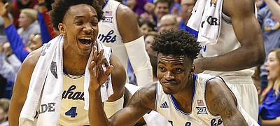 Kansas guard Lagerald Vick (2) and Kansas guard Devonte' Graham (4) break out into a dance after a three pointer by teammate Tyler Self late in the second half, Tuesday, Nov. 29, 2016 at Allen Fieldhouse.