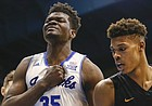 Kansas center Udoka Azubuike (35) pounds his chest after a dunk during the second half, Tuesday, Nov. 29, 2016 at Allen Fieldhouse. At right is Long Beach State forward LaRond Williams.