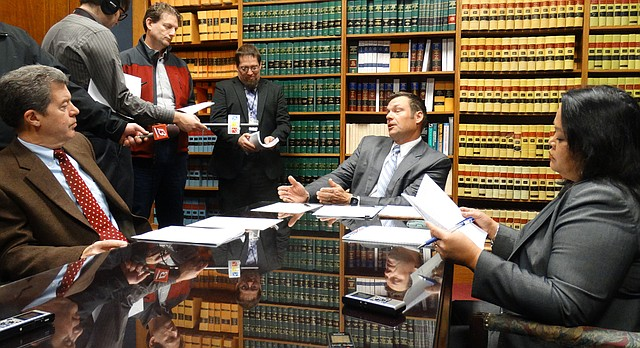 The Kansas State Board of Canvassers, which includes Gov. Sam Brownback, Secretary of State Kris Kobach, Deputy Attorney General Athena Andaya, met Wednesday to certify results of the 2016 elections in Kansas. Kobach said afterward that he accepts President-elect Donald Trump's false assertion that the number of illegal votes cast in the election exceeded Democrat Hillary Clinton's margin of victory in the popular vote.
