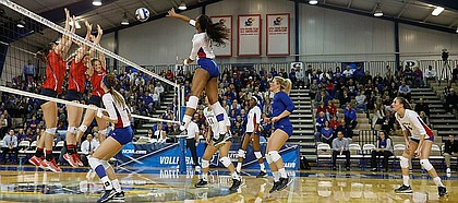 Kansas outside hitter Jada Burse (4) makes a kill for a point in the Jayhawks three-set sweep against Samford University in the first round of the NCAA women's volleyball tournament Thursday, Dec. 1, at Horejsi Family Athletics Center.