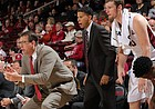 First-year Stanford coach Jerod Haase, who played at Kansas from 1995-97, will return to Allen Fieldhouse on Saturday, Dec. 3, 2016, to lead his Cardinal against Bill Self and the Jayhawks. This photo, taking during a Stanford game earlier this season, shows Haase (in red tie) in a pose similar to the defensive stances that made him a fan favorite during his days at Kansas.