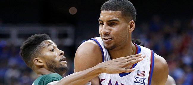 Kansas forward Landen Lucas (33) pulls away a rebound from UAB guard Dirk Williams (11) during the first half of the CBE Classic on Monday, Nov. 21, 2016 at Sprint Center.